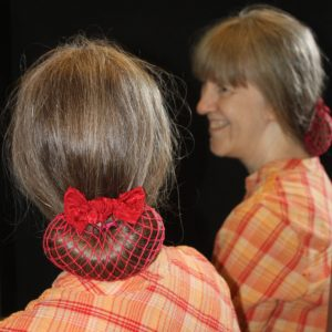 plain stitch snood being worn at the nape of the neck