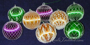 a collection of satin ornament balls covered with netting