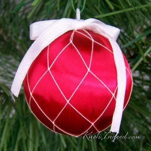satin ornament ball enclosed in decorative netting