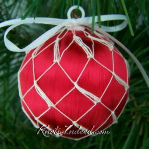 satin ornament ball enclosed in decorative netting