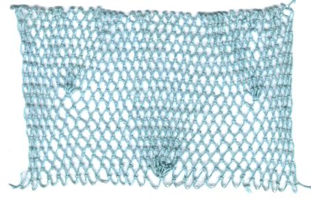 row 18 of Pinecone Cluster Decrease netting stitch