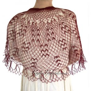 Luminescence doily made as a red shawl using fingering weight yarn
