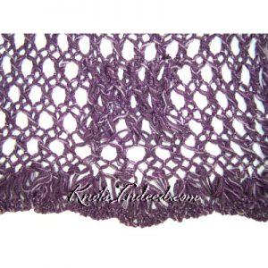 a net scarf close-up of the edge, eyelet stitch, and tube used to fasten the scarf